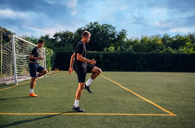 Two men training for soccer